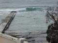 Wave breaking over Austinmer Ocean Pools
