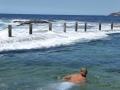 Swimming in the waves at Mahon Pool at Maroubra