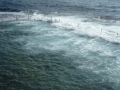 Waves breaking over Wylie's Baths at Coogee