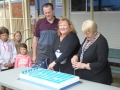 Shellharbour Mayor cuts the Oak Flats Pool birthday cake